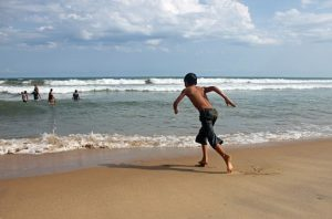 boy on beach pixabay