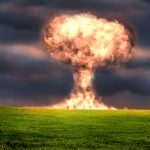exploding nuclear blast from the ground with a fireball explosion up into the sky