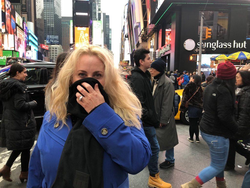 Amy Alton using a bioscarf as a mask.